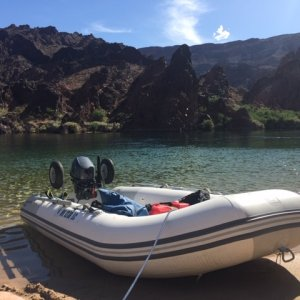 2018 Zodiac and Yamaha 15 beached on river.